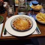 Cheese and onion pie with regular chips and salad
