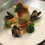 Plaice Stuffed With Mixed Seafood Served with Lemoncello Creamy Sauce. Bon Appetit Chef David Le