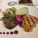 Salmon with quinoa, sauteed veggies and a dill garlic sauce.