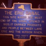 The historic marker for the end of the Erie Canal.