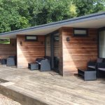 The long porch at the burrow with sitting areas for each room and the lounge area as well