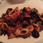 Mussels, clams, calamari and shrimp in a light tomato sauce with angel hair pasta