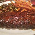 ribs with sweet potato fries and brussel sprouts with bacon and pecans