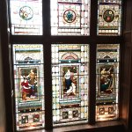 stained glass window on the half landing