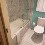 Bathroom with WC, bath tub and shower