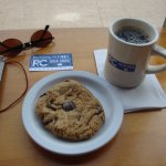 Dark coffee with a yummy cookie