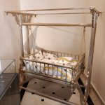 Lot of silver artefacts - baby's cradle, for one....