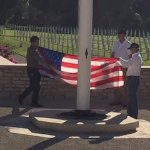 Taking down the flag at the end of the day.