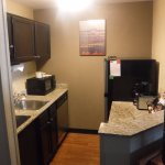A full kitchen with dishwasher, micoowave, stove top and refer.