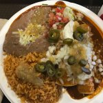 Ground Beef Enchilada Plate with chile gravy, frijoles, Mexican rice, and pico de gallo