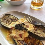 """Sigh...local beer + POGACICE, fried bread: Don't miss it! In background, """"macaroni."""""""