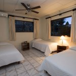 Crocodile Bay Resort - Villa Bedroom with 3 beds