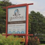The large sign in front of the Grand Oak.