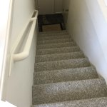 stairs from the bedroom to the shower/toilet