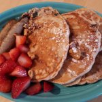 Banana walnut pancakes with berries and turkey sausage