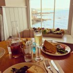 crab sandwiches and prosecco with a sea view