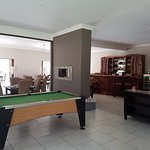 Dining room with the bar & pool table, with full view of swimming pool