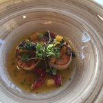 Scallops in broth with citrus accompaniment