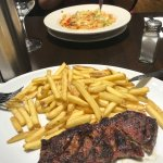 Huge portions. Shrimp pasta and delicious sirloin.