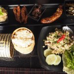 Platter dish with different Lao delicacies, sticky rice and minced fish