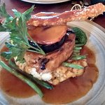 Pork belly with crackling, mustard mash, apple and black pudding