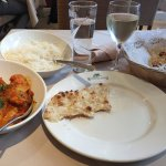 My dinner - vegetables in a spicy tomato sauce, rice and naan bread with a glass of wine
