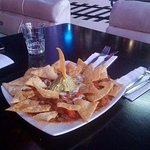 Nachos with great onion flavor, great guacamole and spice