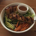 Grilled Lemongrass Chicken Skewer With Spring Rolls On Vermicelli