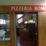 doorway into Pizzeria Roma
