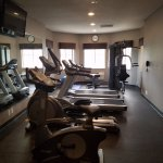 Exercise facility with a bike, eliptical, 2 treadmills, and a multipurpose weight machine