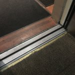 worn, dirty, frayed carpet in the old, slow elevator