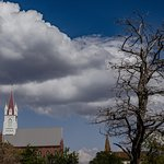 Bare branches, clouds, and steeple