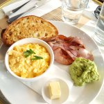 Breakfast - scrambled eggs with bacon and smashed avo