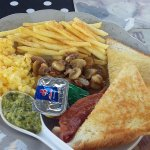 bacon, egg, chips, mushroooms, toast, butter, jam, fresh herb coulis for only R40.