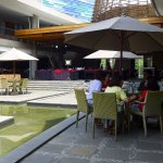 The sitting area between the restaurant and the swimming pool