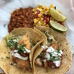 Fish tacos with baked beans and corn salad.
