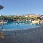 The amazing pool surrounded by sun loungers and pool bar on the left.