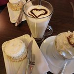 Hot chocolate (with the heart), coffee Chantilly, and brie au kirsch