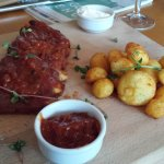 Ribs with baked potato, mayonnaise with garlic and bbq sauce