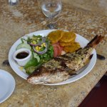 Whole red snapper, grilled with garlic butter. Yummy!