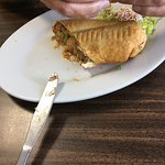 Chimichanga - chicken, beans, rice, lettuce, tomatoes, onion,cilantro & cheese deep fried