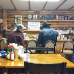 Three cowboys at the bar in the Buffalo Valley Cafe -- with NPR on the radio!