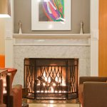A cozy fireplace in the lobby greets you.