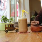 Cool down with a smooth and creamy Iced Latte from @steamer Coffee Shop.