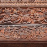 Fine wooden carving on top of building