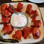 Grilled sausage rolled in pita bread with a tomatoe sauce and a yougart dip