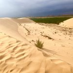 white sand dunes before storm