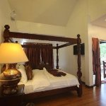 The king-sized bed at Beachfront Executive Villa 3