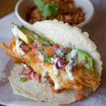 Our staple - the Dos Equis battered fish taco on a homemade corn tortilla.