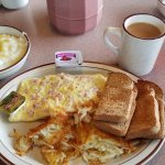 Ham and cheese omelette, home fries, coffee and grits